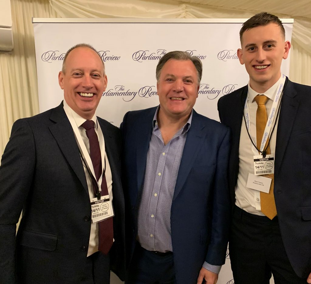 Gary Venner and Ryan Venner with Ed Balls at the Parliamentary Review